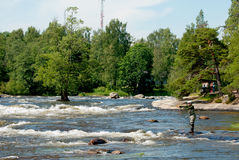 Kotka. Finland. Fisherman near Langinkoski Rapid Royalty Free Stock Photography