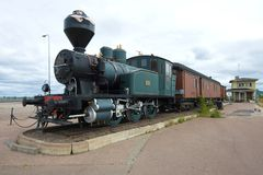 Old steam locomotive Vr1 before 1942 - L1, nickname - Chicken with wagons in the sea center of Vellamo cloudy day. Kotka, Finlan Stock Photo