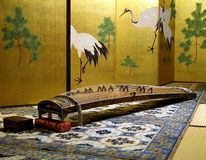 Koto. Is a specific Japanese musical instrument.Here it is in a very specific Japanese room,with paper painted walls and decorated on the floor with Turkish Stock Image