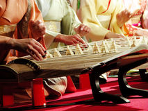Koto band. Close up of women hands wearing kimono and playing traditional Japanese musical instrument-koto Stock Image