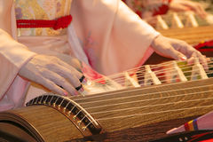 Koto concert. Detail of geisha hands playing koto a traditional Japanese instrument Stock Photos
