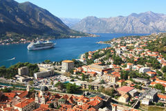 Kotor bay. The view over the old town of Kotor, the bay of Kotor with a big cruise ship at anchor in the waters Royalty Free Stock Photos