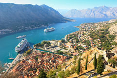 Kotor bay. The view over the old town of Kotor, the bay of Kotor with a big cruise ship at anchor in the waters Royalty Free Stock Photography