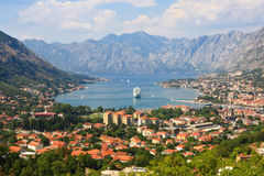Kotor bay and a cruise ship. The view over the mighty mountains surrounding Boca bay or Kotor Bay of Montenegro and a cruise liner at anchor in the bay Royalty Free Stock Photography