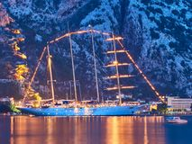 Kotor bay, Kotor Fortress and old sailing ship in Montenegro at night. Water reflexions stock images