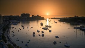 Time lapse of a runrise at marina with boats and buildings in Valletta, Malta. 4K UHD HDR 422 10 bit ProRes. High Quality Time Lapse video of a sun rising with stock video footage