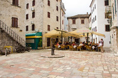 Kotor. At the Cafe. KOTOR, MONTENEGRO - MAY 17, 2013: Old Kotor City in Montenegro, Europe as the people are enjoy at the cafe. On May 17, 2013 in Kotor Stock Image