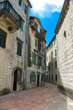 Kotor city. The street paved with stone blocks and old buildings in the Kotor, Montenegro Royalty Free Stock Photo