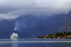Kotor - Cruise ship, lake and mountains Stock Image