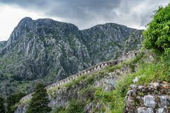 Kotor Fortress on mountainside above old town in Montenegro stock photography