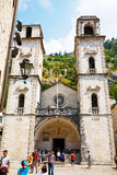 Kotor, Montenegro - August 10, 2015: Saint Tryphon cathedral with tourists in the old town of Kotor, Montenegro. Royalty Free Stock Photography