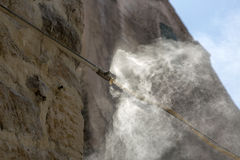 Spraying water with a fog formation system Stock Photos