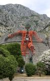Giant figure of a man mounted on Kampana Tower on the eve of XXV Kotor Festival of Theatre for Children. KOTOR, MONTENEGRO - JULY 20, 2017: Giant figure of a man Stock Photo
