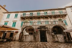 KOTOR, MONTENEGRO - november 30, 2018: The Pima palace is seen at the Trg od Brasna square Flour square Montenegro. - Image