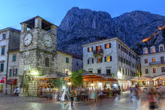 Kotor, Montenegro. Scene in the medieval town of Kotor, Montenegro at twilight, featuring the Square of Arm and the clock tower near the Maritime entrance gate Royalty Free Stock Photos