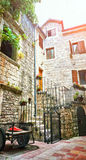 Kotor narrow small streets of  historical old town. House drying linen  bright sun blind old stone. Authentic structures. No body Royalty Free Stock Photo