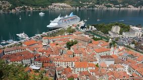Kotor Old Town and Cruise Ship, Montenegro. Roofs Kotor Old Town and cruise ship high view, Montenegro stock photo