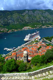 Kotor port view,Montenegro. Beautiful view of the Old Town of Kotor,luxury cruise ship anchored at Kotor port and picturesque Kotor gulf.The old Mediterranean Stock Image