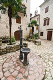 Kotor. Public Water Pipe. Public water pipe in the old town of Kotor, one of the most famous places on Adriatic coast of Montenegro Stock Photo