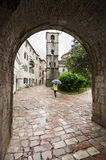 Kotor. A Rainy Day. View belfry through an arch in the wall of Kotor, Montenegro Stock Photography