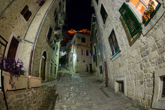 Kotor touristic center - the old town historical buildings at narrow street night photo. Montenegro. Kotor touristic center - the old town historical buildings royalty free stock photography
