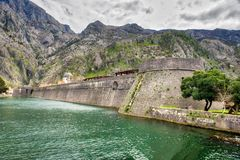 Kotor Walls Montenegro. The old Mediterranean port of Kotor is surrounded by fortifications built during the Venetian period. It is located on the Bay of Kotor stock images