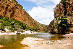 Kouga River Gorge in South Africa. Red Enon Conglomerate Formation and sandstone cliffs of the Cape Folded Mountains seen in a gorge on the Kouga River near royalty free stock photo