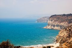 Kourion coast with blue sea and sky with clouds Stock Photos