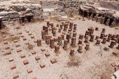 KOURION CYPRUS/GREECE - JULI 24: Rest på nollan för forntida stad arkivfoto