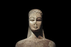 Kouros of the sacred gate. Ancient statue of young man on black background. Kerameikos museum, Athens Greece Royalty Free Stock Photos