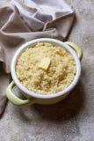 Kouskous met boter in pot royalty-vrije stock afbeelding