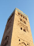 Koutoubia mosque in Marrakesh. Mosque and a half moon above (Koutoubia mosque in Marrakesh, Morocco Royalty Free Stock Image