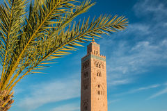 Koutoubia Mosque and palm at blue sky background Royalty Free Stock Photo