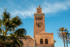 Koutoubia Mosque and palm trees in Marrakech at evening Stock Photo
