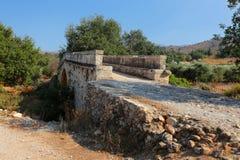 Koutsos Bridge on Crete. Historic 19th Century Koutsos Bridge near Vrises in the Apokoronas area of central Crete, Greece. It was built to serve an adjacent mill Royalty Free Stock Image