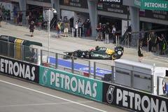 Kovalainen beendet pitlane am Malaysian F1 Stockbild