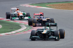 Kovalainen vs Ricciardo vs Di Resta - F1 2012 Stock Photos