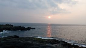 Sunrise, sunset, Kovalam Beach, Thiruvananthapuram, Kerala. Kovalam Beach, Thiruvananthapuram, Kerala, India. This place is quite interesting nature lovers Stock Photos