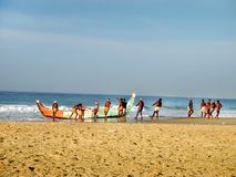Fishermen are pulling out fishing boat at Kovalam stock photo