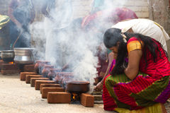 KOVALAM, KERALA, INDIA, April 1, 2015: Some women devotees participate in Pongala ceremony where boiled rice made in stock photography