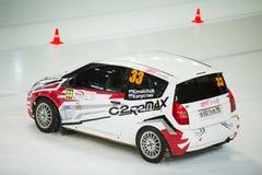 Kovalchuk and Kapustin in racing car on ice Stock Photos