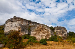 Kovan Kaya. The array of trapezoidal niches Kovan Kaya is one of the largest complexes carved into the rock trapezoidal niches in the Eastern Rhodopes. Rock Royalty Free Stock Photo