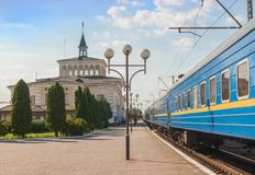 KOVEL, UKRAINE: The building of Kovel railway station. KOVEL, UKRAINE - 5 JULY, 2018: An Ukrainian Railway Ukrzaliznytsia locomotive with a passenger train stock photos