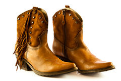 Kowbojów buty na białych tło akcesoriach Zdjęcie Royalty Free