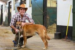 Kowboj psie stajenki fotografia royalty free