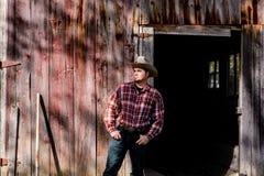 Kowboj w flaneli i kciukach w kieszeni Zdjęcie Royalty Free
