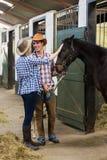 Kowbojska cowgirl para Zdjęcie Stock