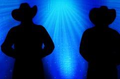 Kowbojska sylwetka, Błękitny tło obrazy stock