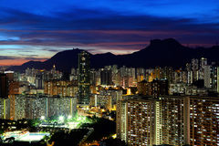 Kowloon cityscape in Kong Kong with lion rock mountain Stock Photos