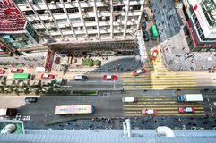 Looking down on a busy Nathan Road from Chungking Mansions, Hong. KOWLOON, HONG KONG - MARCH 20, 2014 - Looking down on a busy Nathan Road from Chungking royalty free stock photo